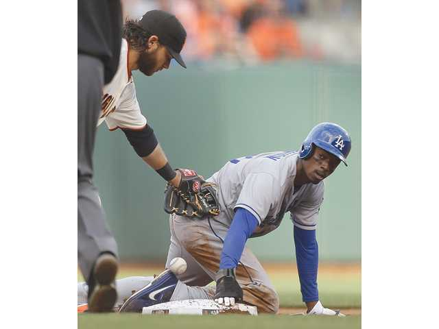 Los Angeles Dodger Dee Gordon, right, steals second base on Sunday in San Francisco.