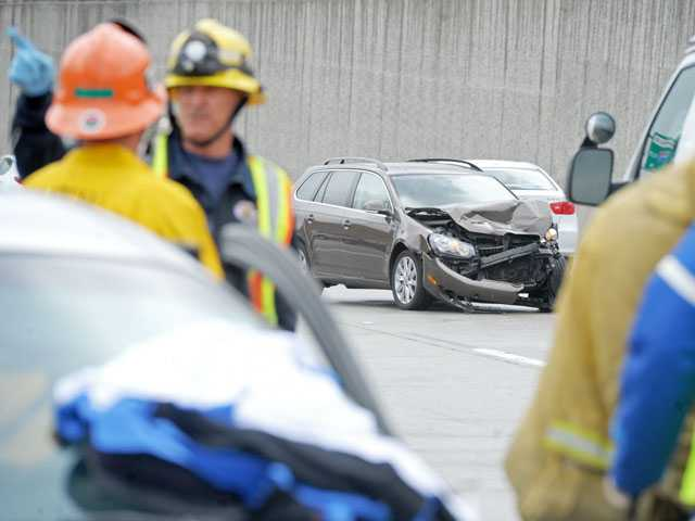 First responders work a 3-car collision on southbound Interstate 5 south of Highway 14 in Sylmar on Monday. (Jonathan Pobre/The Signal)