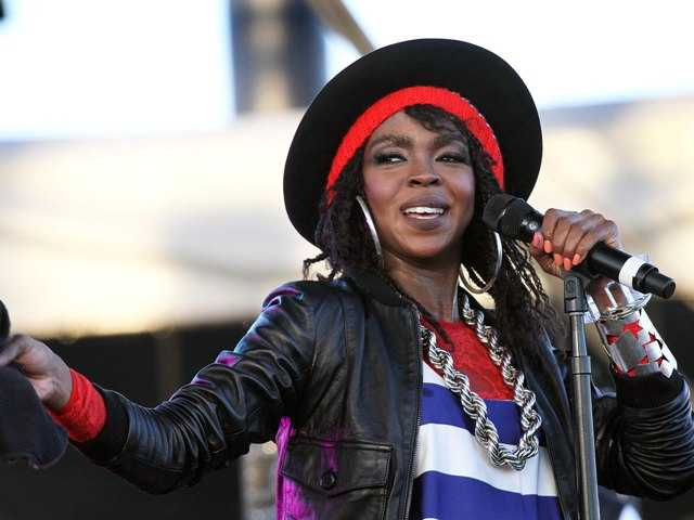 Lauryn Hill performing during the Coachella Valley Music and Arts Festival in 2011. Hill was sentenced to three months in prison for failing to pay taxes.