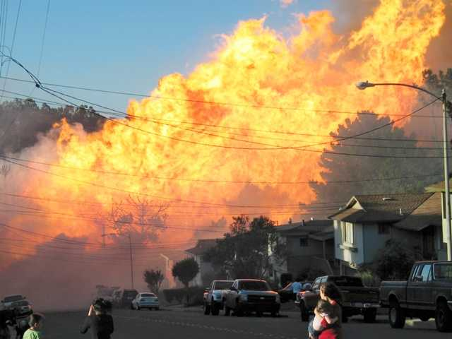 A massive fire in a residential neighborhood in San Bruno in 2010. The California Public Utilities Commission said PG&E should pay a $2.25 billion fine for its negligence.