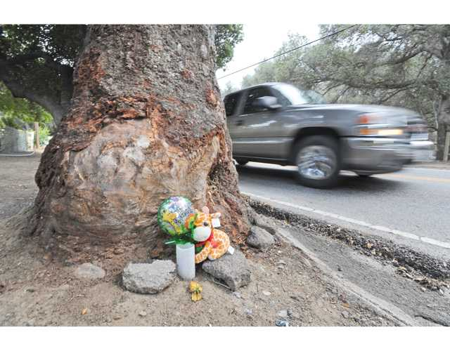 A memorial for Brittany Schlumpberger can be seen Tuesday at the base of the oak tree where she died. Signal photo by Dan Watson
