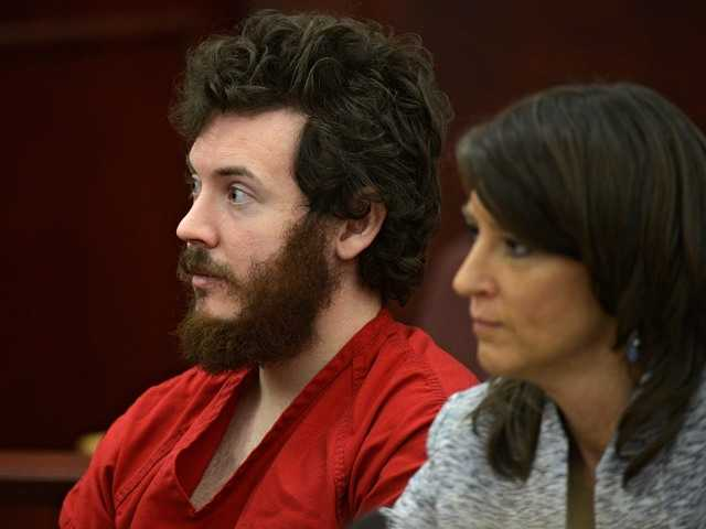 James Holmes, left, wants to change his plea to not guilty by reason of insanity. Holmes is accused of killing 12 people and injuring 70 in a Colorado movie theater.