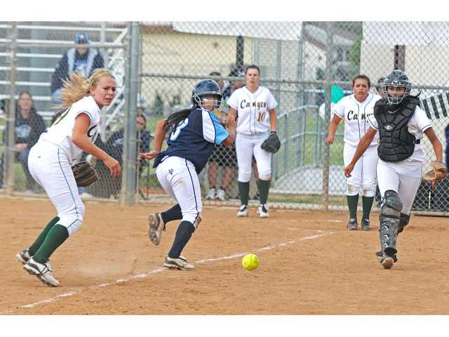 Saugus' Diana Mendoza (3) is caught in a rundown between Canyon shortstop Tiffany Dyson, left, and catcher Julianna Carlos, right at Canyon High School on Tuesday. Mendoza would score on an error.