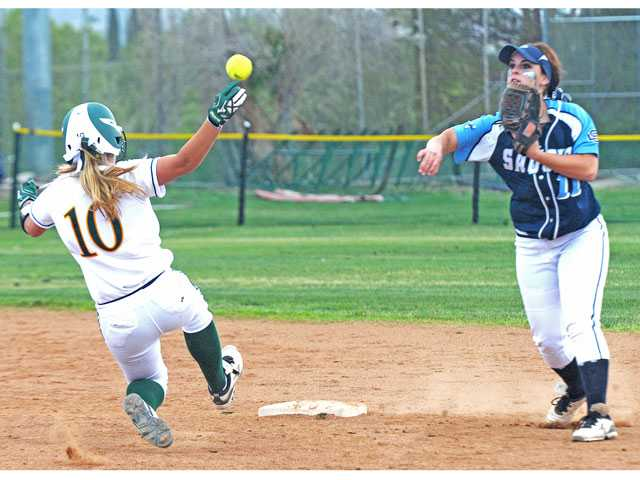 Saugus' Rachel Shotzbarger (11) turns a double play as Canyon's Alexis Williams slides to second in the second inning on Tuesday at Canyon High.