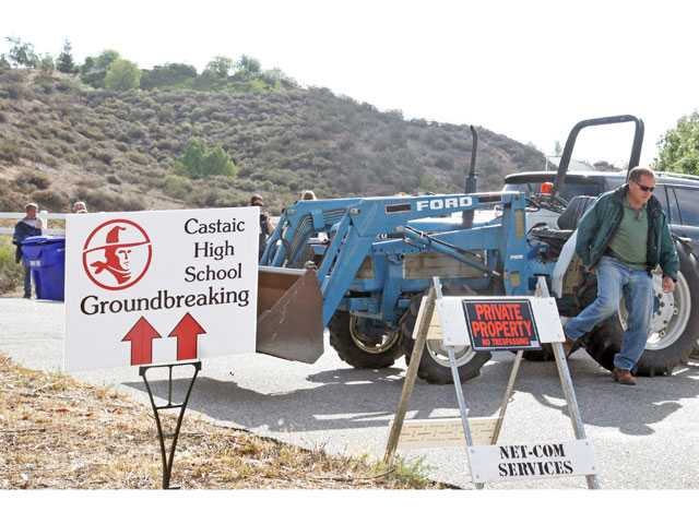 Castaic resident Marvin Metcalf parks his tractor to temporarily block traffic on Romero Canyon Road Wednesday morning. Romero Canyon residents set up several temporary roadblocks to protest the private road being used to get to the ceremonial groundbreaking for the Castaic High School project.