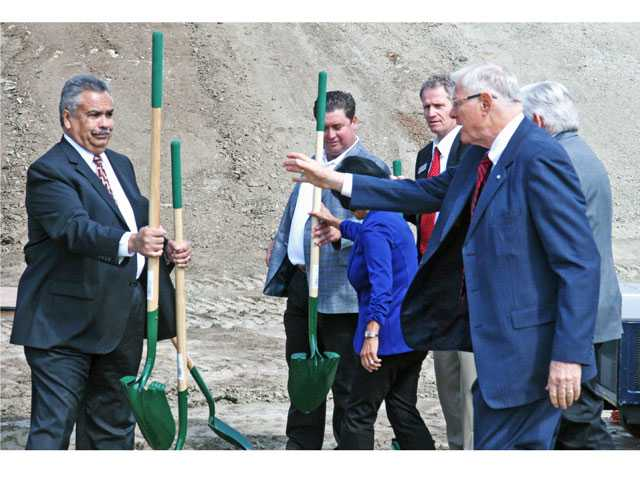 William S. Hart Union High School District Chief Operations Officer Ben Rodriguez, left, hands a shovel to Los Angeles County Supervisor Michael D. Antonovich for Wednesday's groundbreaking ceremony for the Castaic High School project in Romero Canyon. About 100 people attended the ceremony.