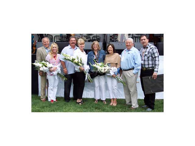 Left to right, Don and Billie Hubbard, John and Debbie Heys, Lois Bauccio, Julie and Steve Sturgeon and Darrell Paulk. The Hubbards, Heys and Sturgeons served as co-chairs of the 25th annual Taste of the Town.