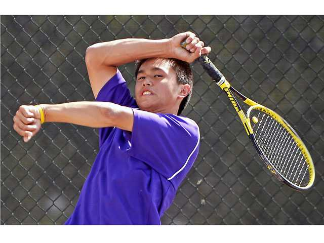 Valencia's Joseph Hwang returns the ball during a doubles match against Rio Mesa on Wednesday at Valencia high School. Valencia won 14-4. Photo by Jayne Kamin-Oncea.