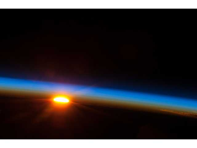 The sun rises over the South Pacific Ocean photographed by one of the Expedition 35 crew members aboard the Earth-orbiting International Space Station photographed the sun rising over the South Pacific Ocean on May 5.