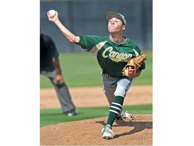 Canyon pitcher Max Weinstein pitches against Valencia on Thursday at Valencia