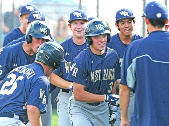 West Ranch teammates surround J.D. Krauskopf (3) after he hit a two-run home run in the seventh inning against Saugus on Thursday at Saugus High School.