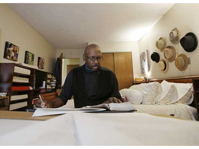 Phillip Patterson transcribes the King James Bible at this home in Philmont, N.Y. on April 30.