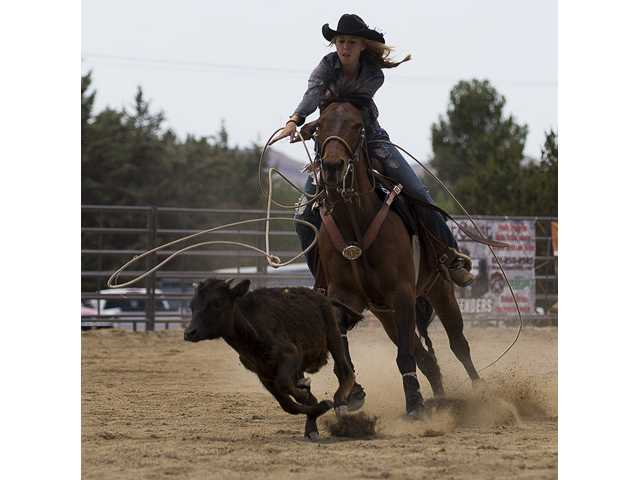 Savannah Simons ropes acalf as quickly as she can in the senior girls breakaway event during the junior rodeo on Sunday in Agua Dulce. Photo by Steve Palma