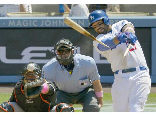 Los Angeles Dodgers outfielder Matt Kemp, right, breaks his bat as he gets his 1,000th career hit on Sunday in Los Angeles.