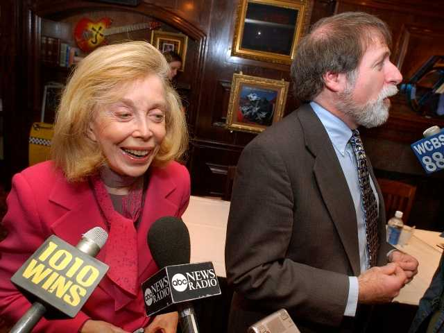 Psychologist Dr. Joyce Brothers, left, and Bruce Spizer at a 2004 news conference in New York. Brothers died on Monday at age 85.