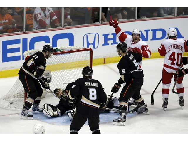 Detroit Red Wings right wing Daniel Cleary, second from right, celebrates a goal by center Henrik Zetterberg, right, as Anaheim Ducks players look on during Game 7 of their first-round NHL Stanley Cup playoff series in Anaheim on Sunday.