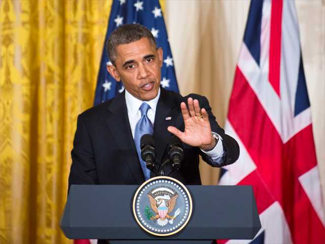 During a joint news conference with visiting British Prime Minister David Cameron, President Barack Obama defends his administration's actions after the wake of the attacks on the U.S. consulate in Benghazi, Libya last year, calling Congressional criticism a political sideshow, at the White House in Washington on Monday.