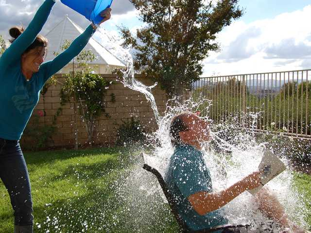 Augie Altes, a Valencia resident and first-grader at Helmers Elementary School, has won the national PTA Reflections competition in the category of photography with this photo of his mother dumping water on his father.
