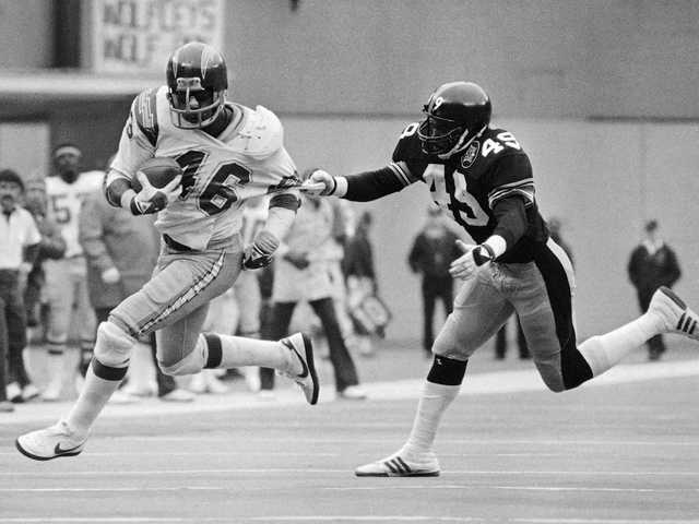 San Diego Chargers Chuck Muncie breaks free as he runs for a gain during the fourth quarter of an NFL playoff game in 1983.