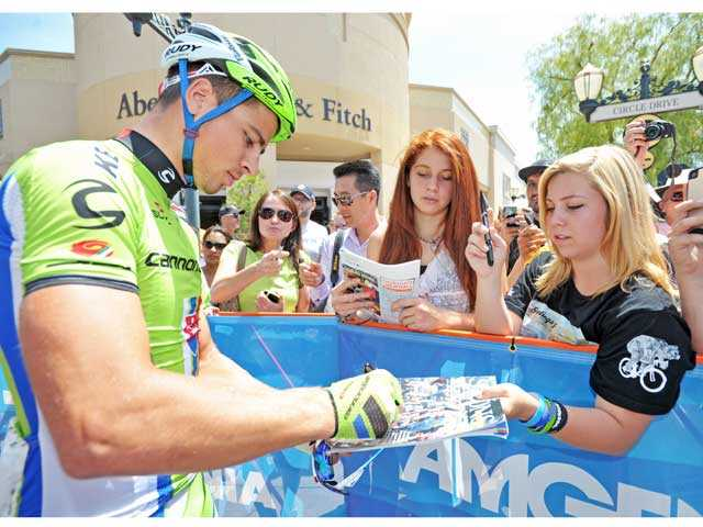 Stage 3 winner Peter Sagan, left, signs autographs for Allexis Grande of Newhall, second from right, and Shelby O'Shea of Valencia. Signal photo by Jonathan Pobre