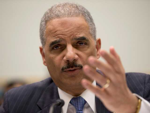Attorney General Eric Holder testifies on Capitol Hill in Washington, Wednesday, on topics including the gathering of phone records at the Associated Press.