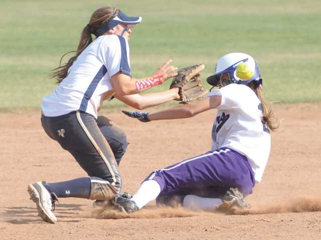 West Ranch's Kylie Sorenson (2) makes the out on Rancho Cucamonga's Justine McLean (21) at second base in the sixth inning at West Ranch on Thursday.