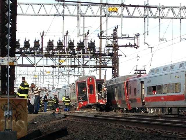 A New York-area commuter railroad says two trains have collided in in Fairfield, Conn. on Friday. AP Photo/The Connecticut Post, Christian Abraham