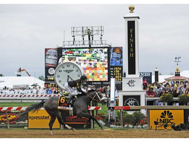 Oxbow, ridden by jockey Gary Stevens, wins the 138th Preakness Stakes at Pimlico Race Course on Saturday in Baltimore.