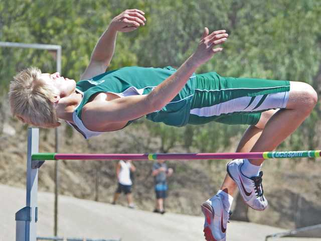 Canyon's Jeremy Kimmer competes in the high jump at the CIF-Southern Section Track and Field Championships on Saturday at Mt. San Antonio College.