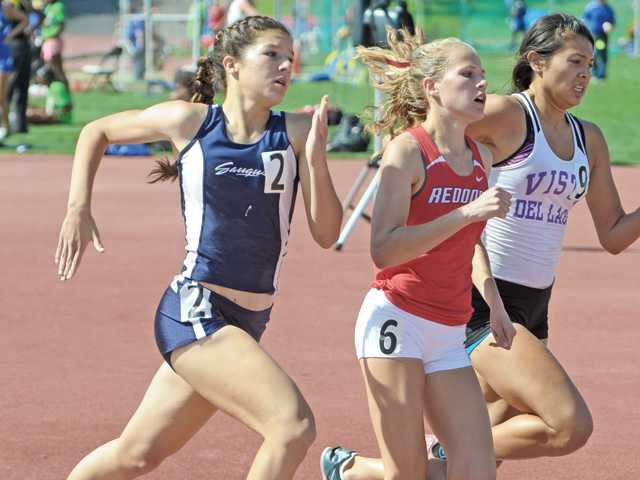 Saugus' Sabrina Janes, left, completes the 800-meter race at the CIF-Southern Section Track and Field Championships on Saturday at Mt. San Antonio College.