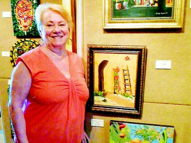 Dody Rogers with her artwork.