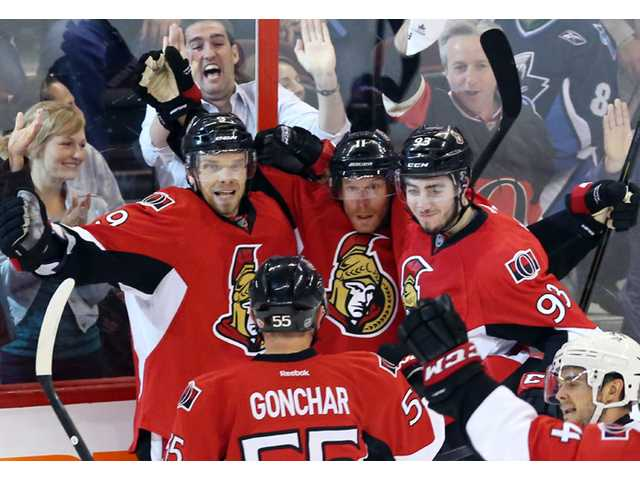 Ottawa Senators Daniel Alfredsson (11) celebrates with teammates Milan Michalek (9), Sergei Gonchar (55) and Mika Zibanejad (93) on Sunday in Ottawa.