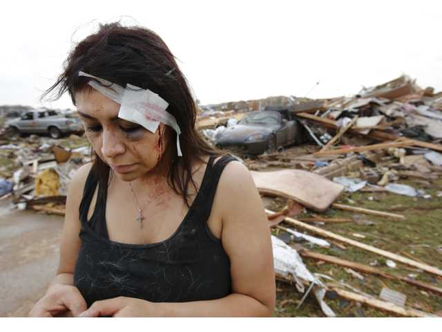 Cindy Wilson texts to friends Monday after her home was destroyed by a massive tornado that ripped through Moore, Okla.
