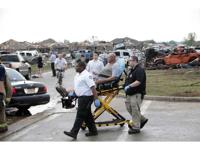 A tornado victim is wheeled to an ambulance in Oklahoma City.