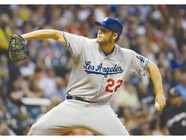 Los Angeles Dodgers starting pitcher Clayton Kershaw throws against the Milwaukee Brewers on Monday in Milwaukee.