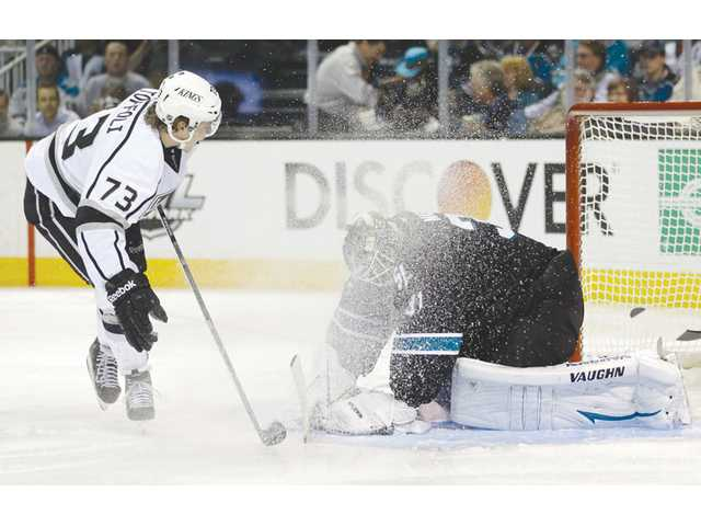 San Jose Sharks goalie Antti Niemi, right, stops a shot attempt from Los Angeles Kings center Tyler Toffoli in San Jose on Tuesday.