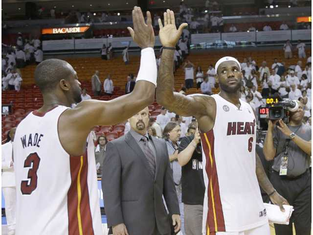 Miami Heat forward LeBron James (6) is congratulated by Dwyane Wade (3) after defeating the Indiana Pacers on Wednesday in Miami.