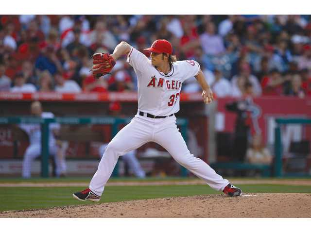 Los Angeles Angels starting pitcher C.J. Wilson throws to the plate against the Seattle Mariners on Wednesday in Anaheim.