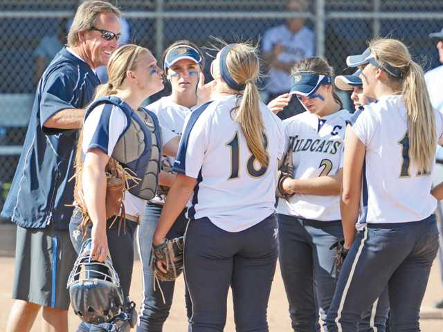 West Ranch head coach Bob Shults, far left, meets with during a CIF-Southern Section Division I game against Santiago High School at West Ranch High on Thursday.