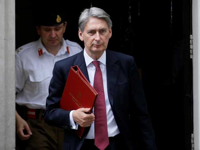 Britain's Defense Secretary Philip Hammond arrives in Downing Street after a meeting of the British government's emergency committee Cobra, in London, Thursday.