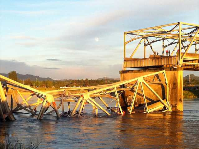 A portion of the Interstate 5 bridge is submerged after it collapsed into the Skagit River dumping vehicles and people into the water in Mount Vernon, Wash. on Thursday.