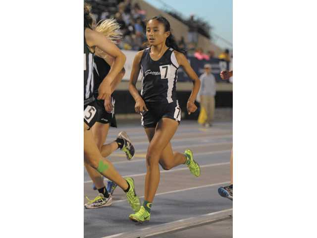 Saugus sophomore Samantha Ortega competes in the 3,200-meter race at the CIF-Southern Section Masters Meet on Friday at Cerritos College.
