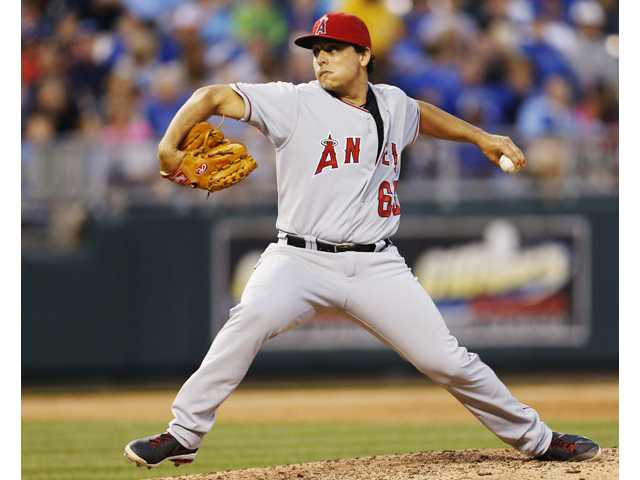 Los Angeles Angels starting pitcher Jason Vargas (60) delivers to a Kansas City Royals at Kauffman Stadium in Kansas City, Mo., on Friday.