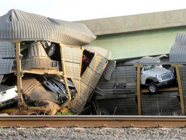 The National Transportation Safety Board has launched an investigation into the cause of a cargo train collision that partially collapsed a highway overpass in southeast Missouri, injuring seven people.