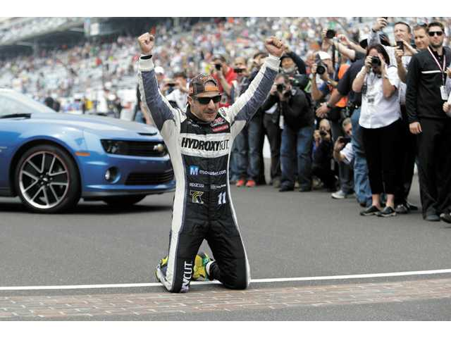 Tony Kanaan celebrates on the start/finish line after winning the Indianapolis 500 auto race at the Indianapolis Motor Speedway in Indianapolis on Sunday.
