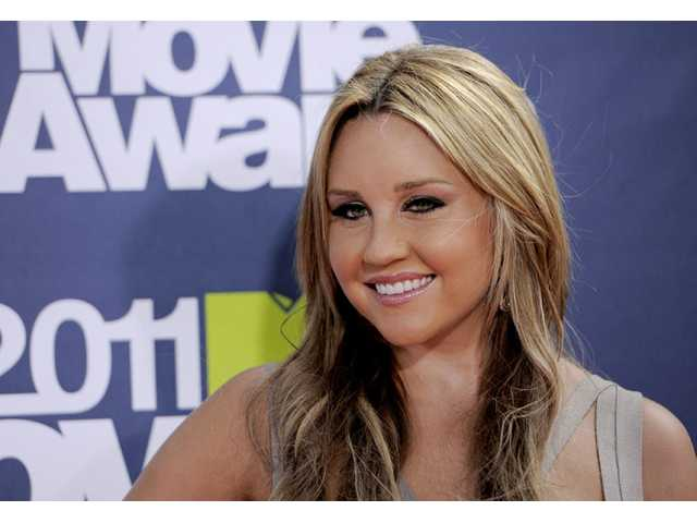 FILE - In this June 5, 2011 file photo, Amanda Bynes arrives at the MTV Movie Awards, in Los Angeles.