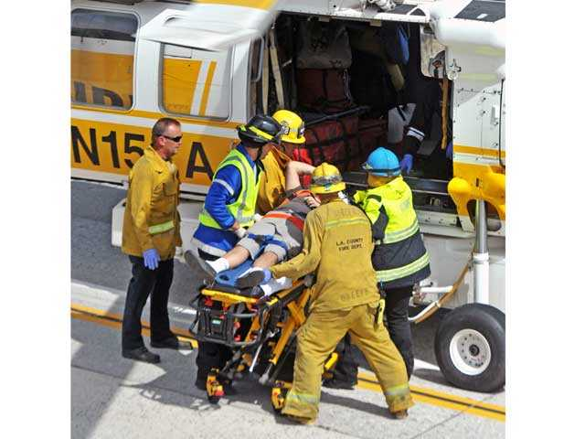 First responders take a patient to a helicopter for transport to a local hospital. Signal photo by Jonathan Pobre