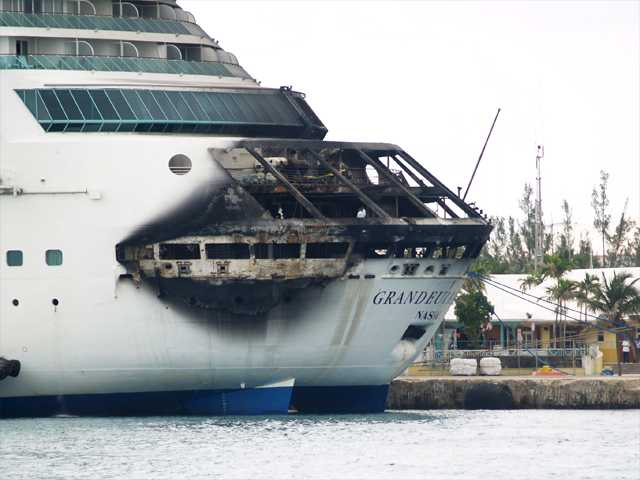 The fire-damaged exterior of Royal Caribbean's Grandeur of the Seas cruise ship is seen while docked in Freeport, Grand Bahama island on Monday.