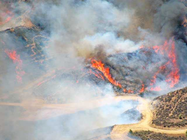 An aerial view of a brush fire in Valencia on Tuesday. Photo courtesy Mike Baez