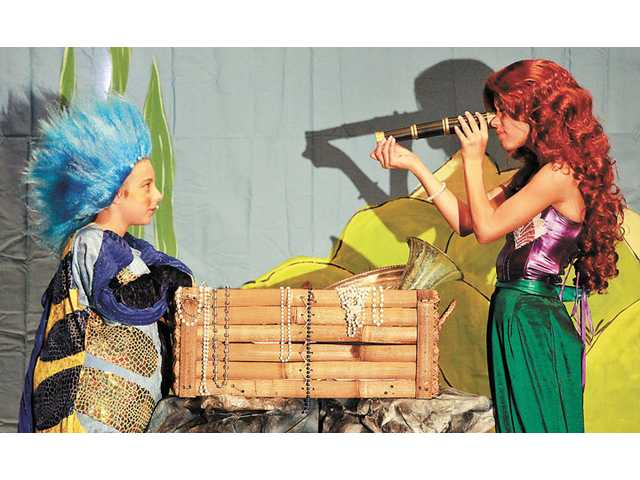 Jack Anderson, left, as Flounder, and Bailey Earhart, as Ariel, check things out during the performance.